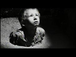 From Schindler's List movie, boy up to his                     chest in latrine waste