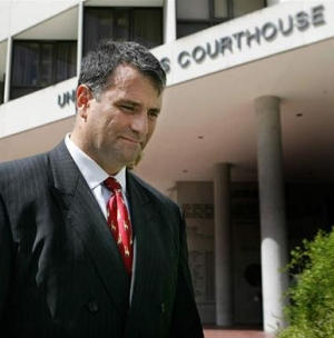 Abramoff, looking busted with courthouse in background