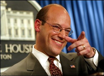 Fleischer, at press conference pointing to reporter; looks like thumb touching nose and index finger extended